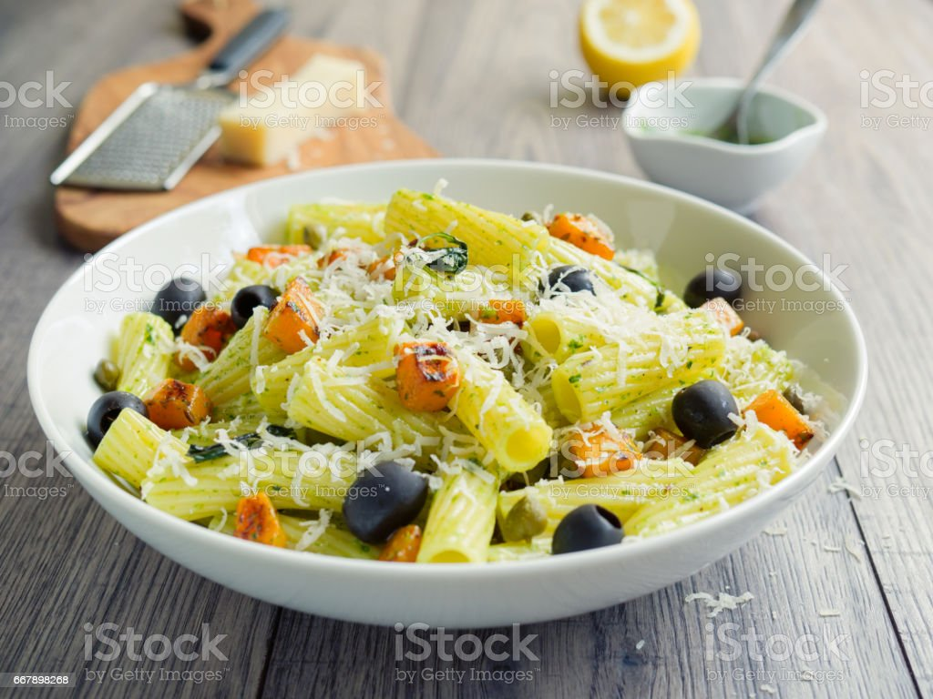 Healthy Pasta salad with roasted butternuts squash stock photo