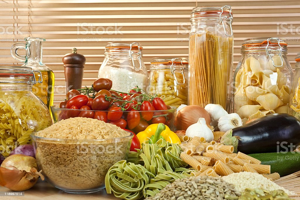 Healthy Pasta, Vegetables, Rice, Grain, Olive Oil, Seeds and Tomatoes royalty-free stock photo