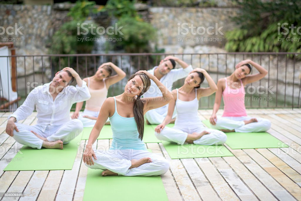 Healthy people in a yoga class stock photo