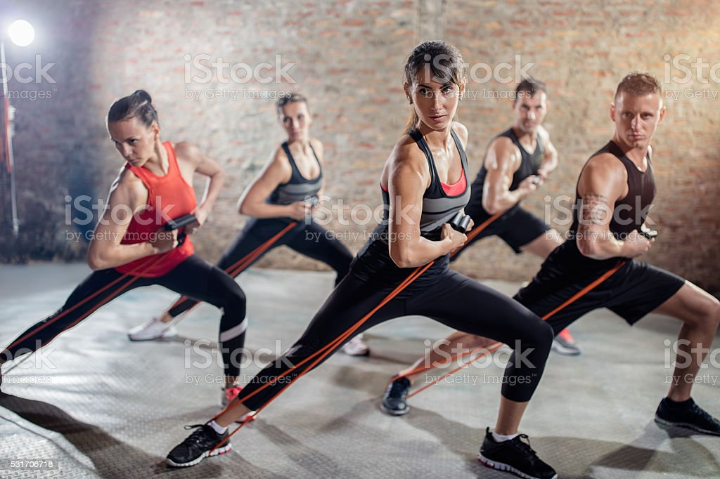 healthy people on group training with resistance band stock photo