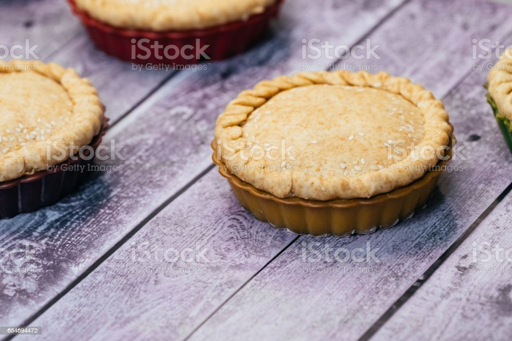 Healthy pie of a round shape on a wooden table stock photo