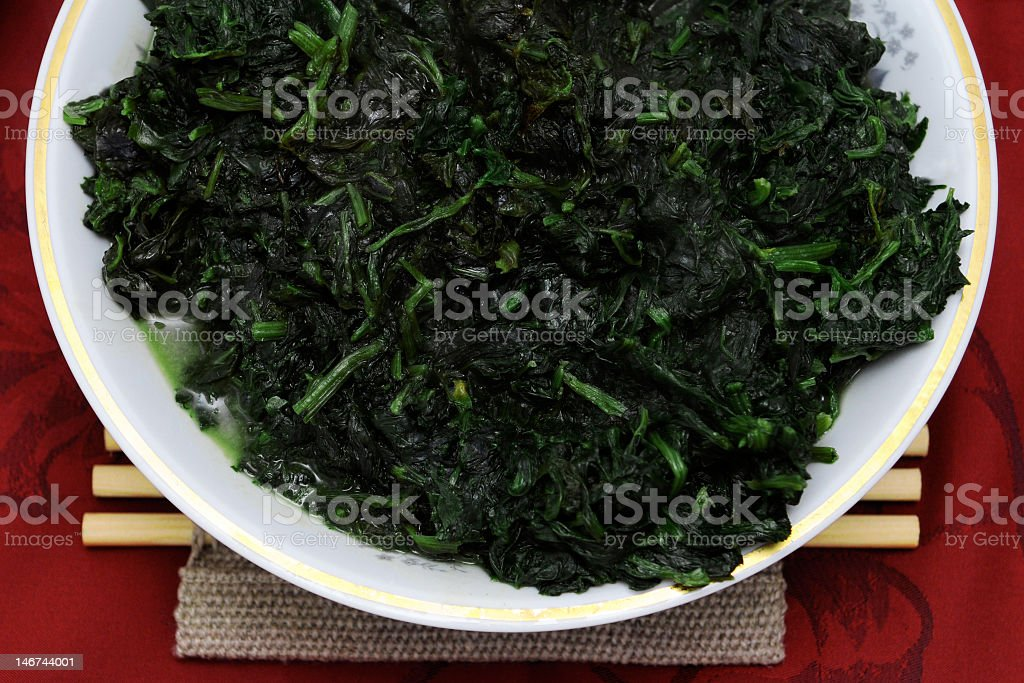 A healthy platter of cooked spinach royalty-free stock photo