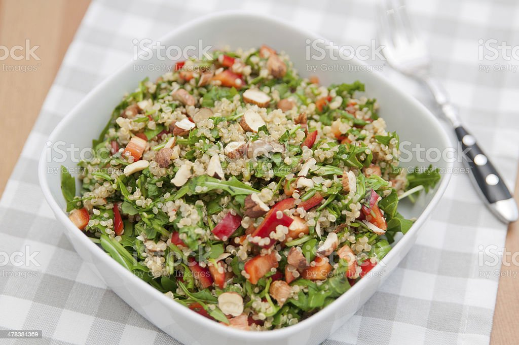 Healthy Quinoa Salad with red pepper and hazelnuts stock photo