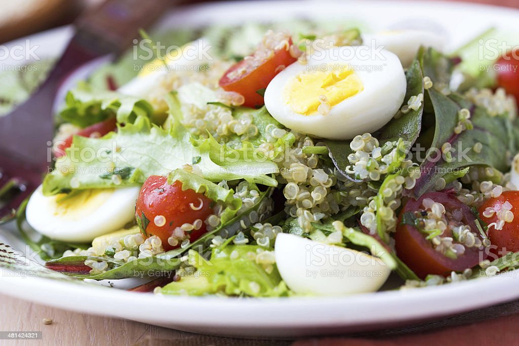 Healthy quinoa salad with tomatoes, avocados, eggs, herbs stock photo