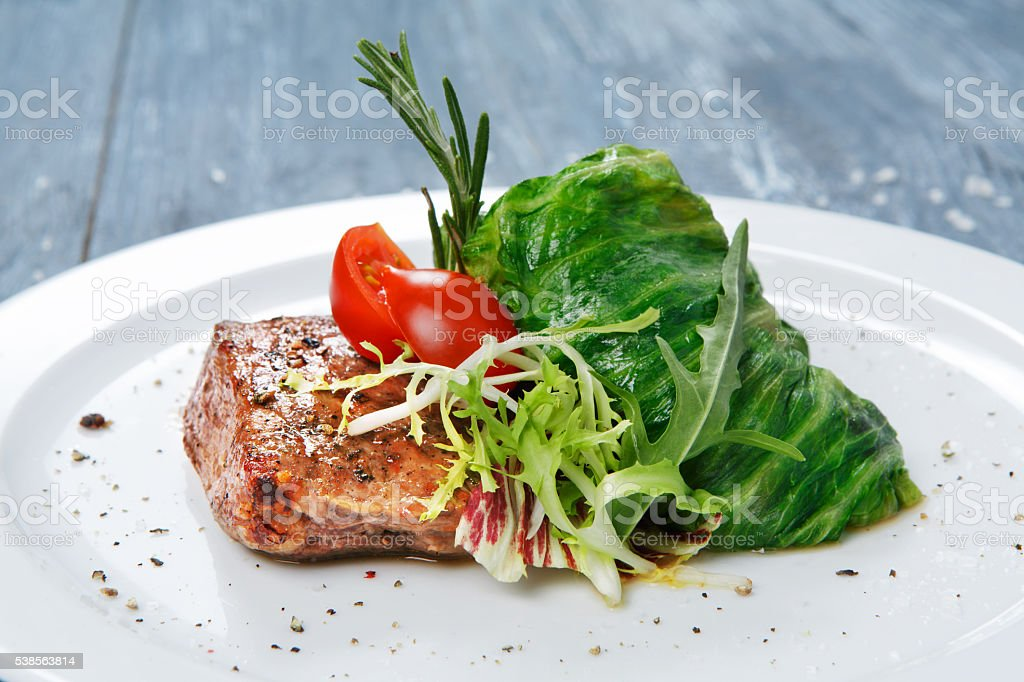 Healthy restaurant food, steak and cabbage roll stock photo