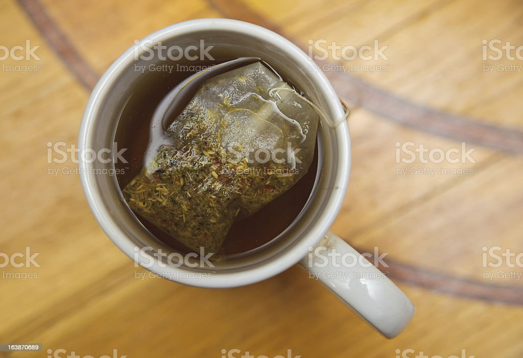 healthy restorative drink. teabag in a cup of tea royalty-free stock photo