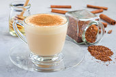 Healthy rooibos red tea latte topped with cinnamon, horizontal