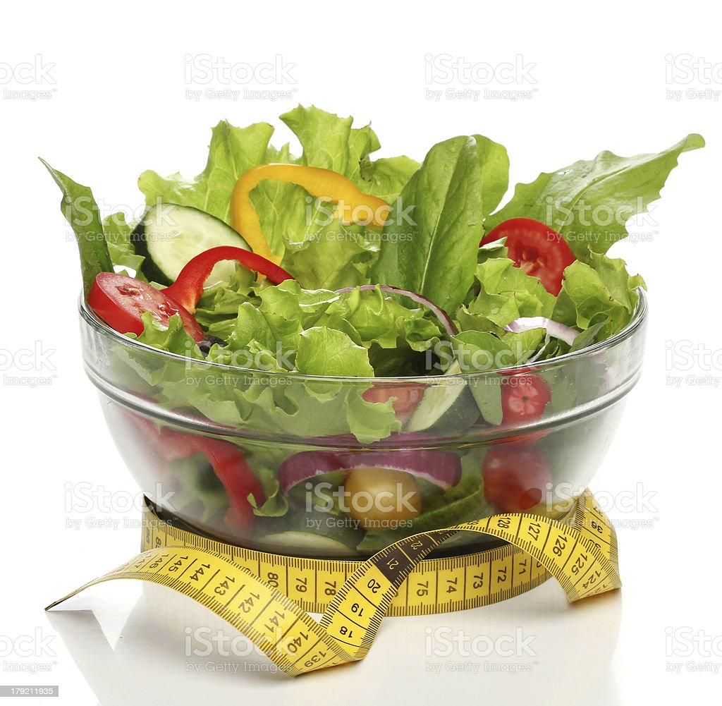 Healthy salad and a measuring tape isolated royalty-free stock photo