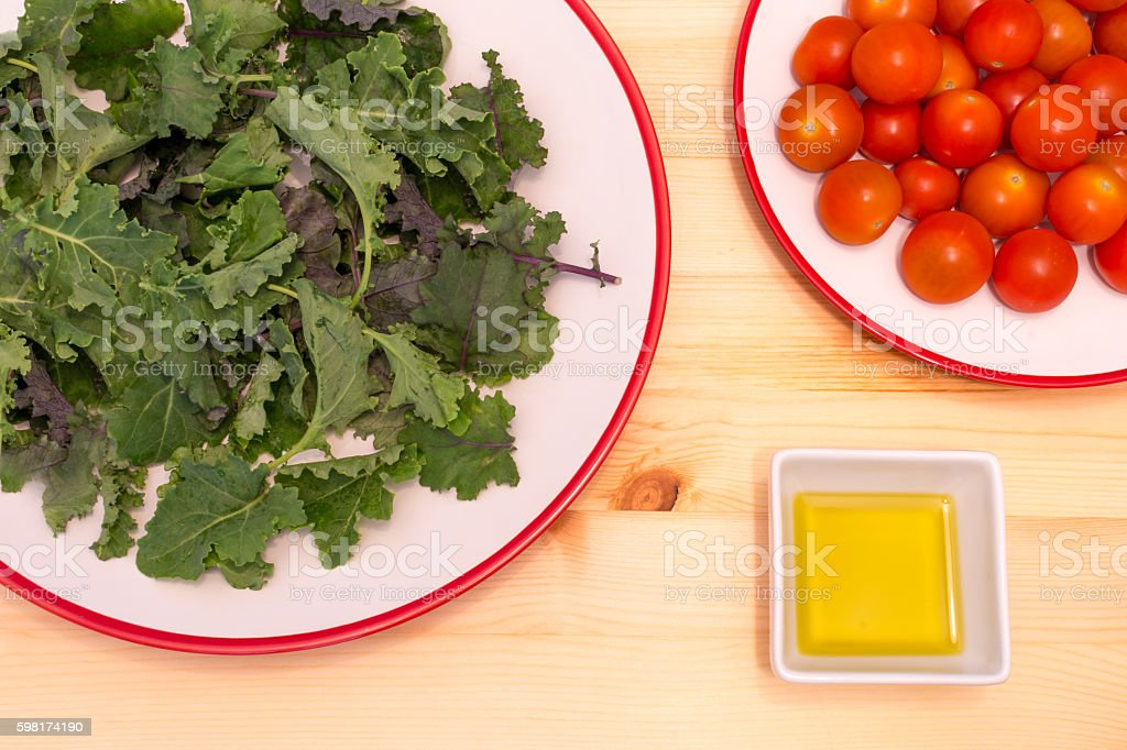 Healthy Salad Kale Tomato and Olive Oil stock photo