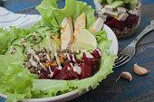 healthy salad with beets, tofu, cucumber, carrots, lentils, peas,