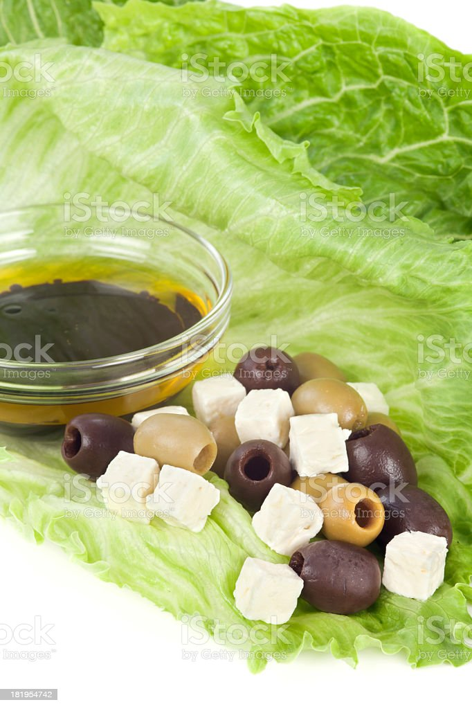 Healthy salad with cheese, olives and dressing royalty-free stock photo
