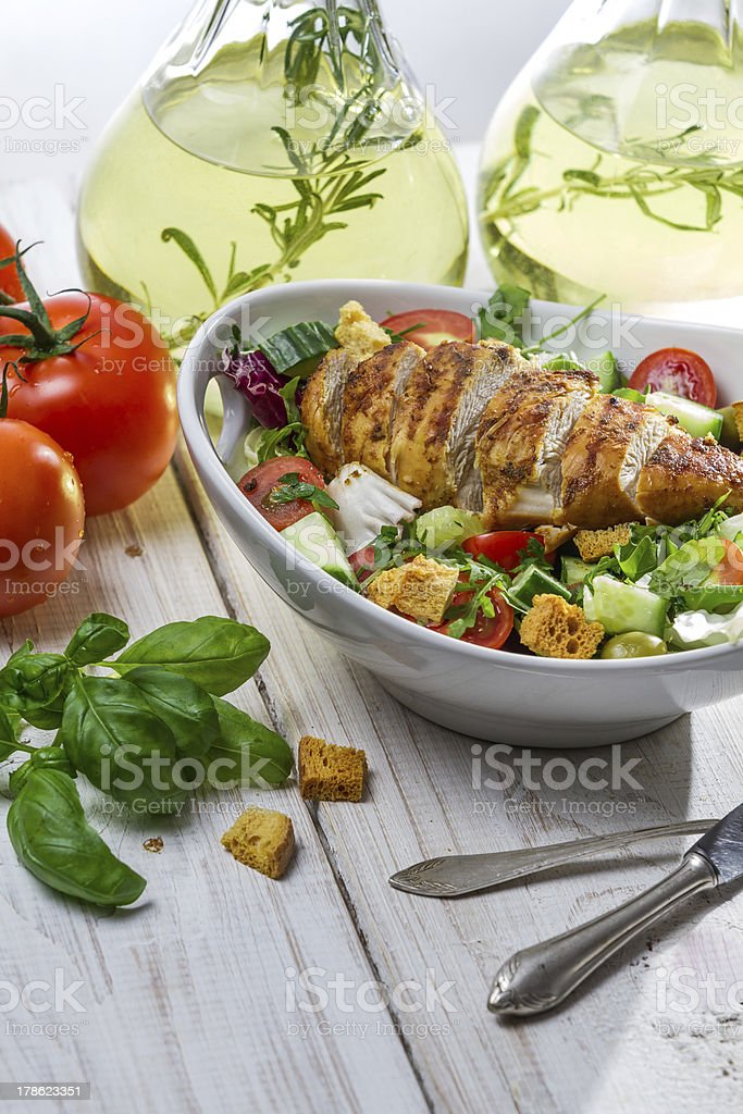 Healthy salad with chicken and olive oil royalty-free stock photo