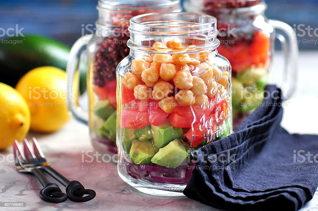 Healthy salad with quinoa and chickpeas, avocado, tomato, red onion stock photo