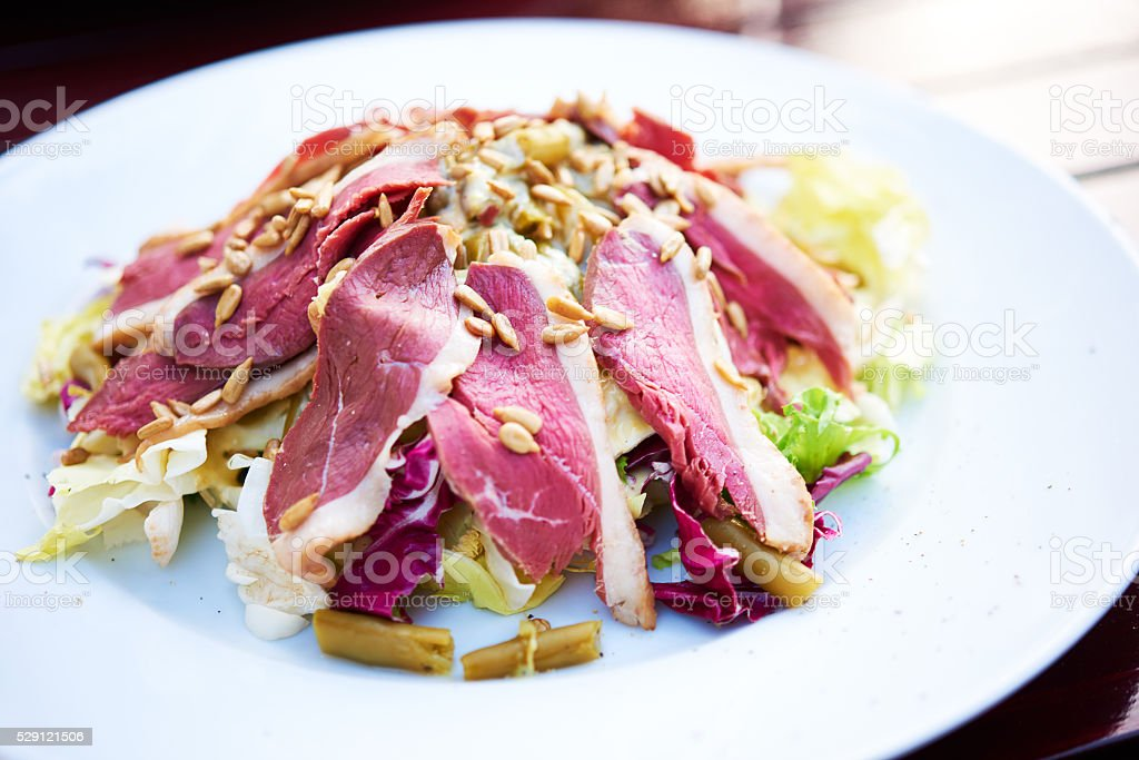 healthy salad with smoked duck breast stock photo