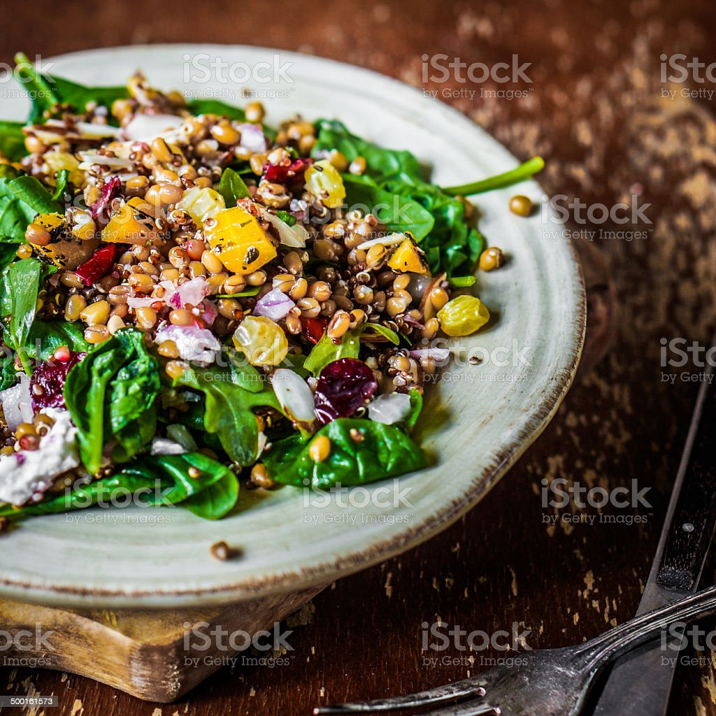 Healthy salad with spinach,quinoa and roasted vegetables stock photo