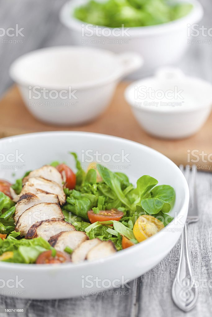 Healthy salad with vegetables and chicken breast royalty-free stock photo