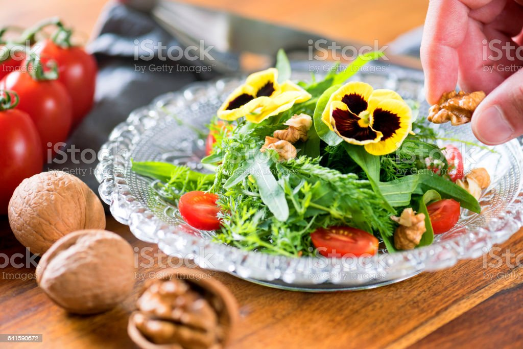Healthy Salad with Wild Herbs and Edible Flowers stock photo