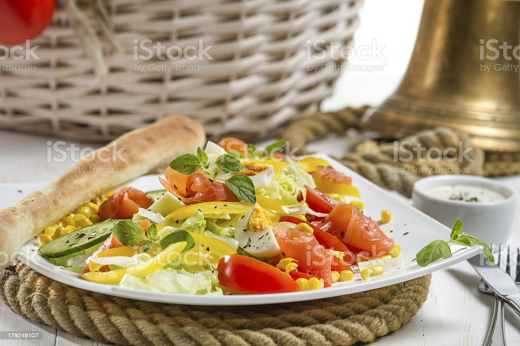 Healthy salmon salad made of fresh vegetables royalty-free stock photo
