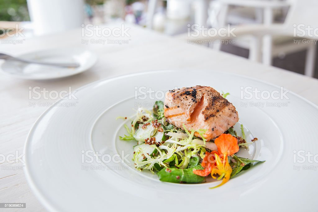 Healthy salmon steak with vegetable stock photo