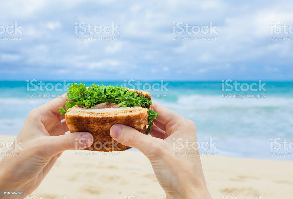 Healthy sandwich on the beach stock photo
