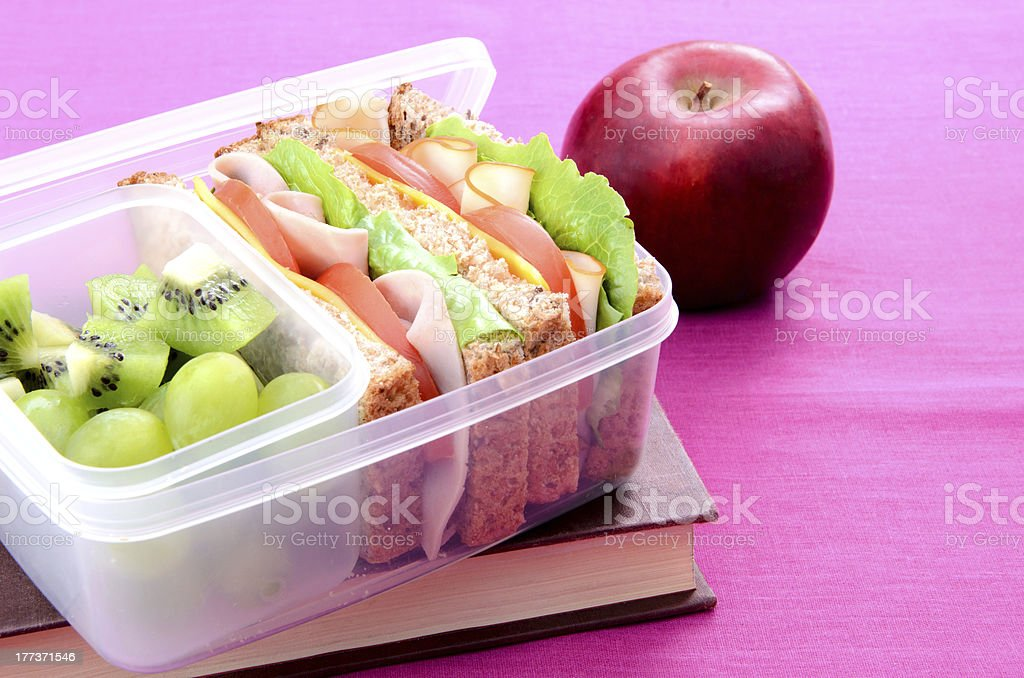Healthy school lunch with book stock photo