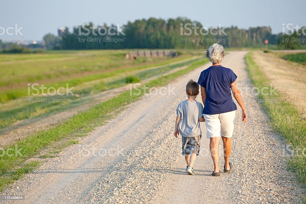 Healthy Senior Caucasian Grandmother Walking with Grandson royalty-free stock photo