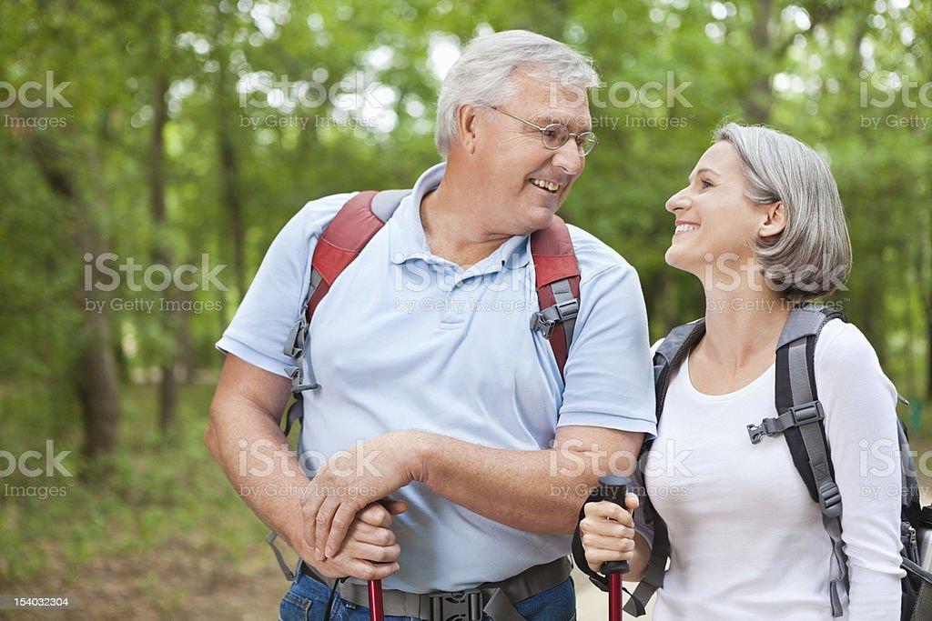 Healthy senior couple enjoying their retirement hiking together royalty-free stock photo