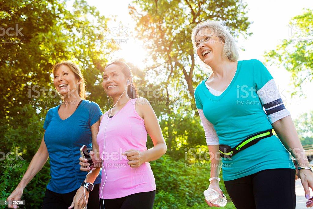 Healthy senior women exercise in park stock photo