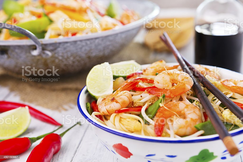 Healthy shrimp and vegetables stir-fry in a bowl, brightly lit stock photo