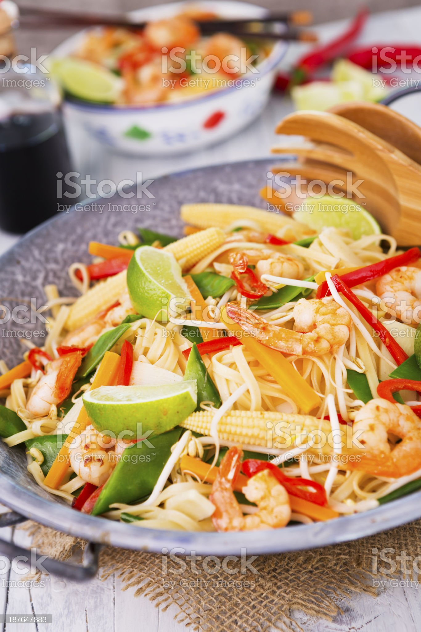 Healthy shrimp and vegetables stir-fry in a wok, brightly lit royalty-free stock photo