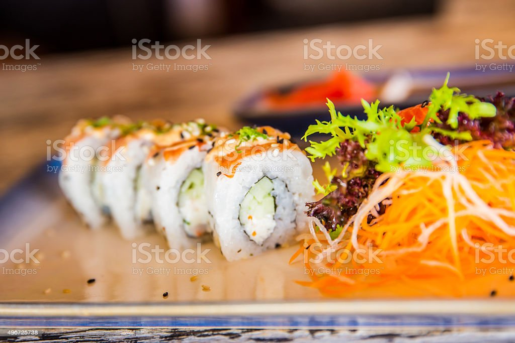 Healthy shrimp sushi roll and salad stock photo