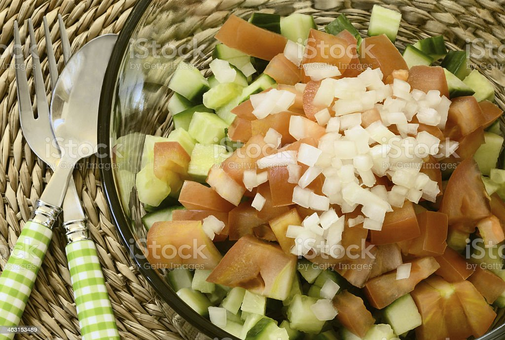 Healthy simple salad with fork and spoon close up royalty-free stock photo