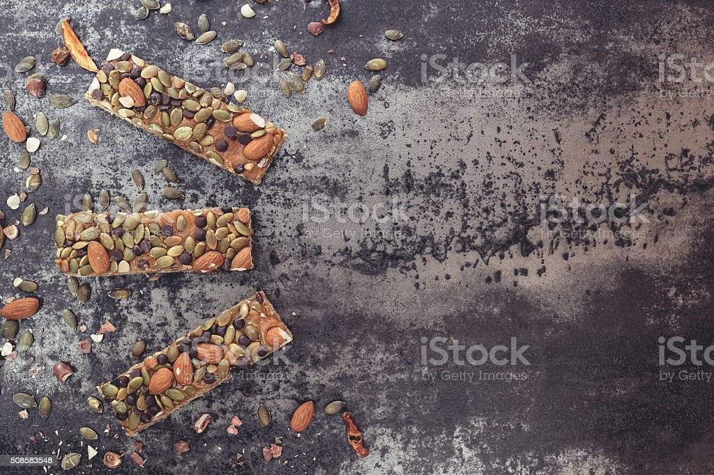 Healthy snack. Granola bars with nuts stock photo