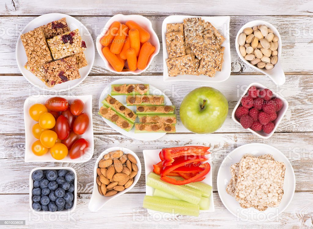 Healthy snacks on wooden table stock photo