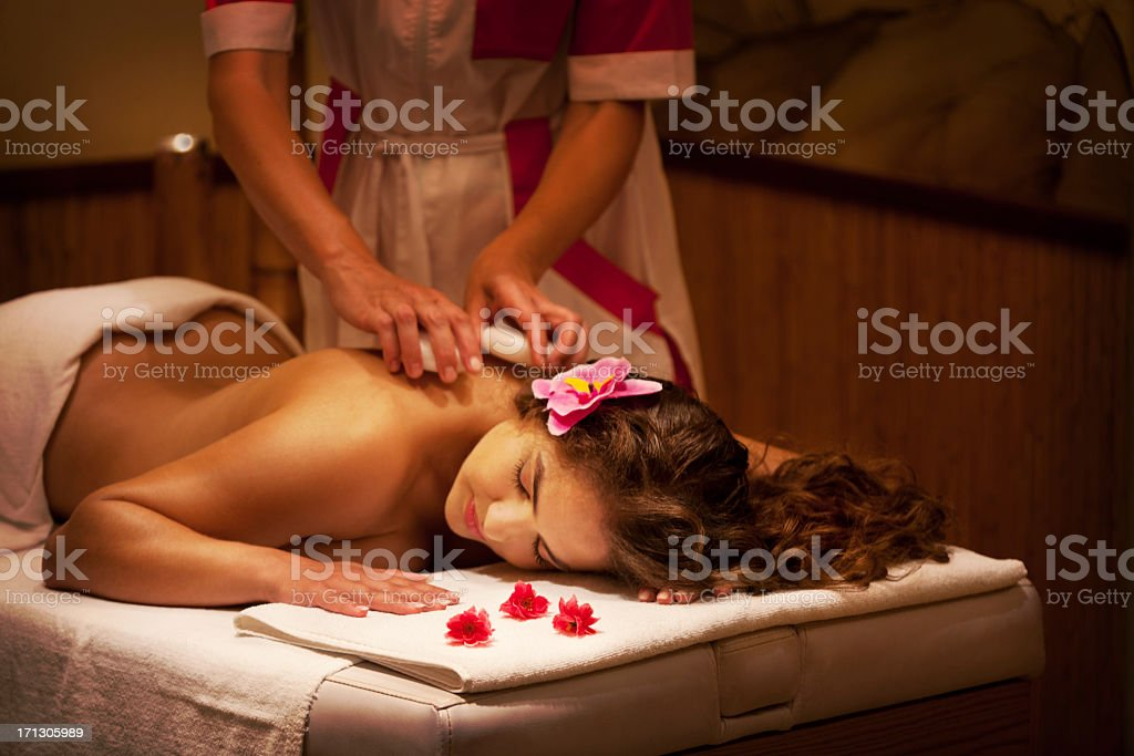 Healthy Spa: Young Beautiful Relaxing Woman Having Stone Massage royalty-free stock photo