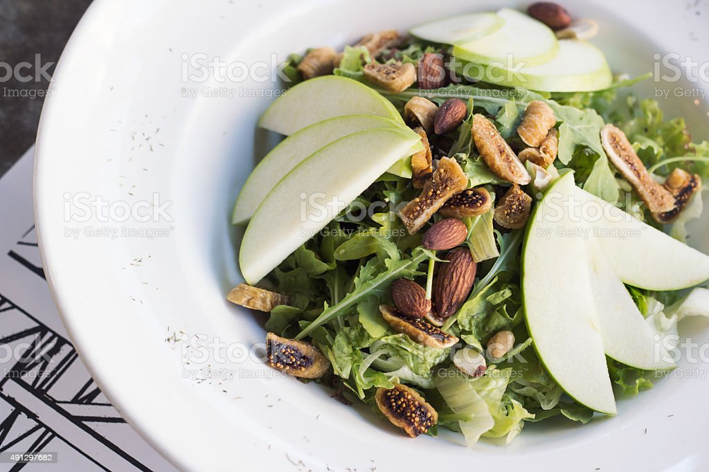 Healthy spinach and arugula salad with cilantro, dried figs royalty-free stock photo