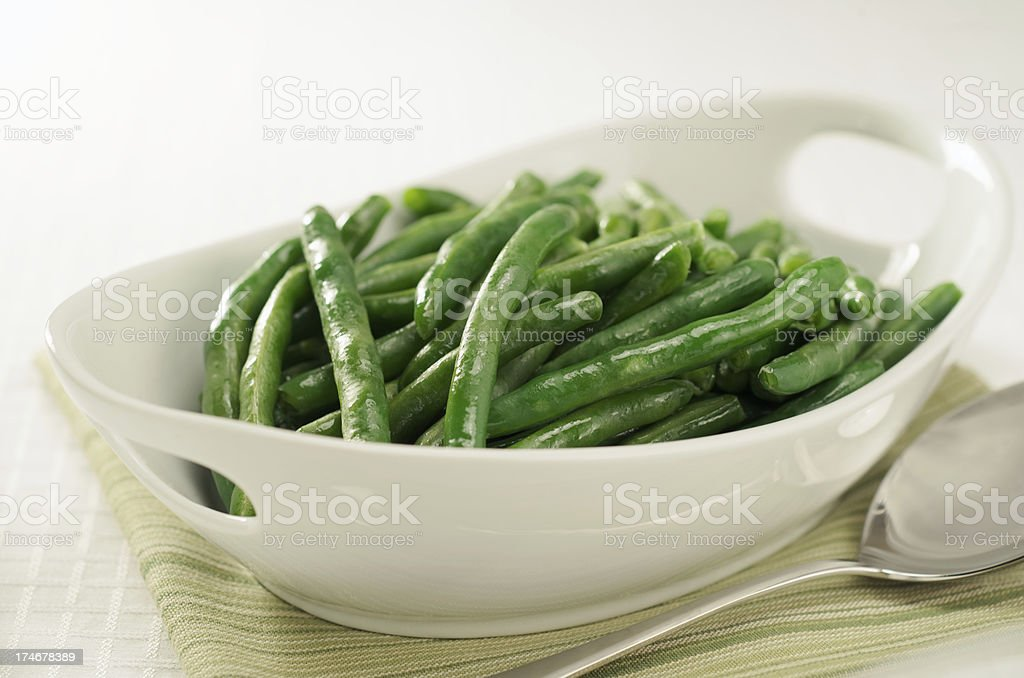 Healthy Steamed Green Beans in White Serving Bowl stock photo