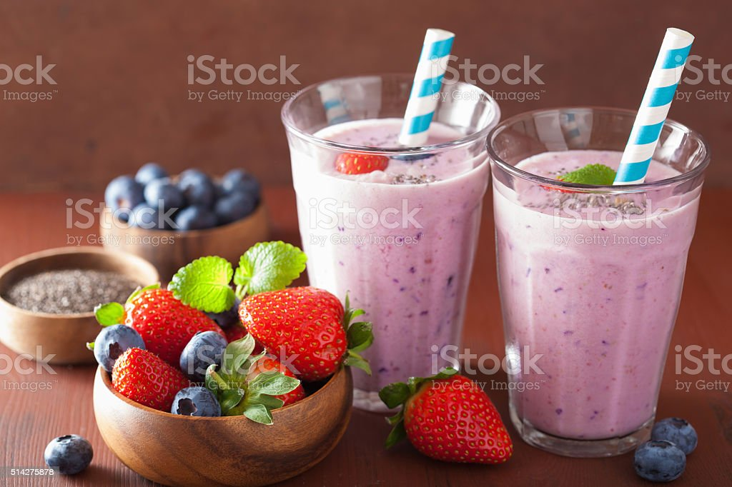 healthy strawberry blueberry smoothie with chia seed stock photo