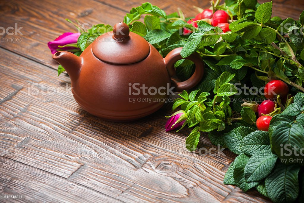 Healthy tea with a dogrose on wooden table stock photo