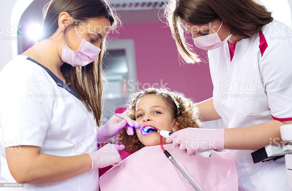 Healthy teeth for cute ginger girl stock photo