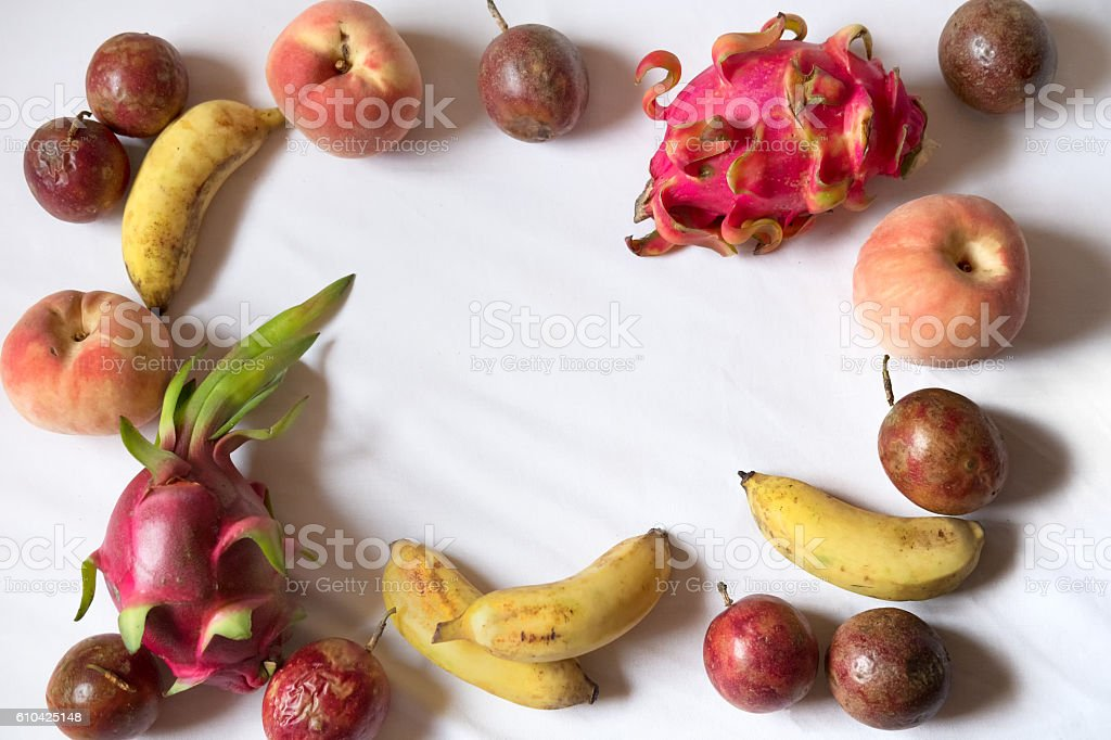 Healthy, Tropical Asian Fruit Assortment Frame on White Sheet Background stock photo
