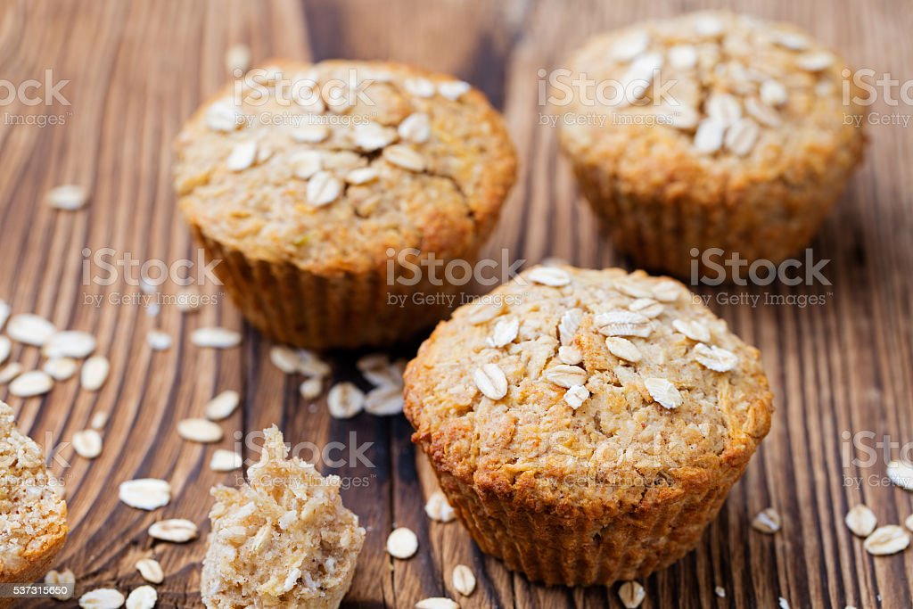 Healthy vegan oat muffins, apple and banana cakes stock photo