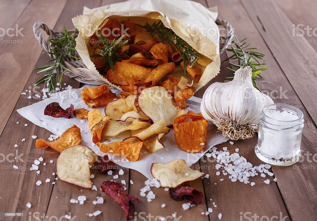 Healthy vegetable chips on paper royalty-free stock photo