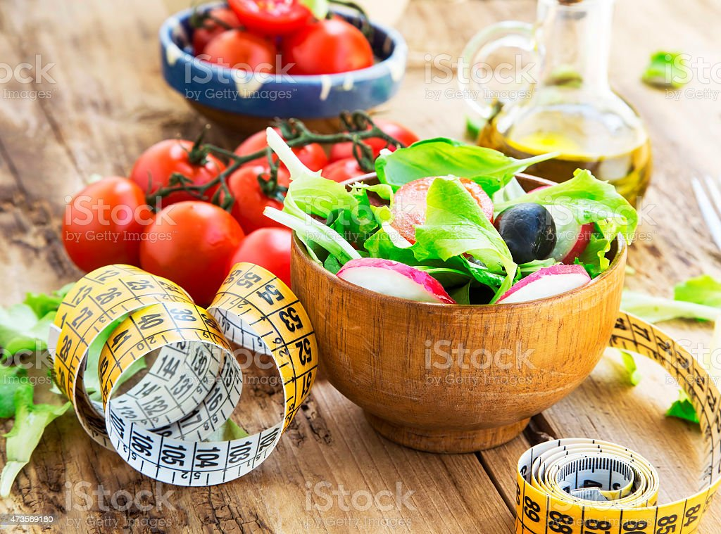 Healthy Vegetables Salad with Measure Tape.Diet Concept stock photo