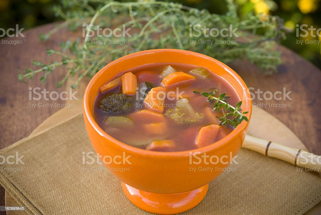 Healthy Vegetarian Vegetable Soup & Carrot, Broccoli, Squash, Tomato & Fresh Thyme stock photo