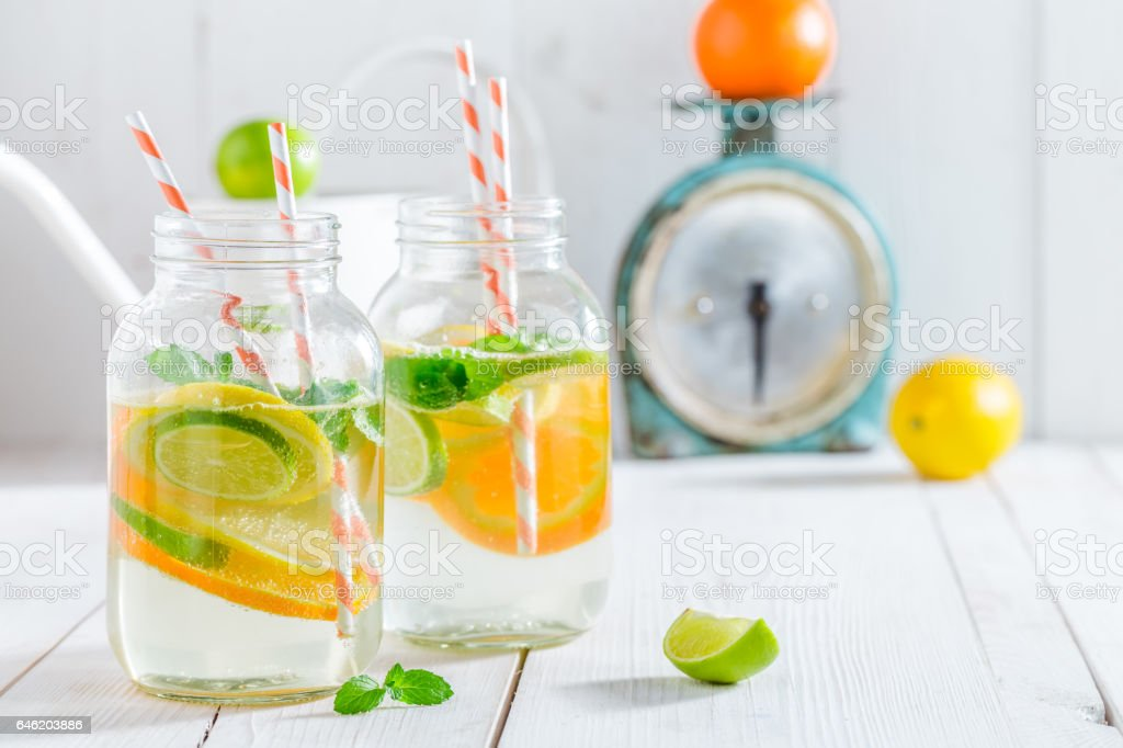 Healthy water with mint leaves and citrus fruits stock photo