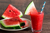 Healthy watermelon smoothie on a wood background