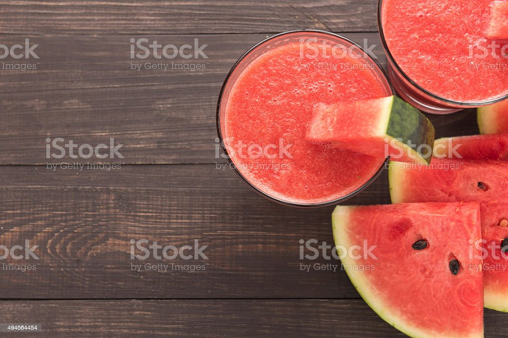 Healthy watermelon smoothie on a wood table stock photo