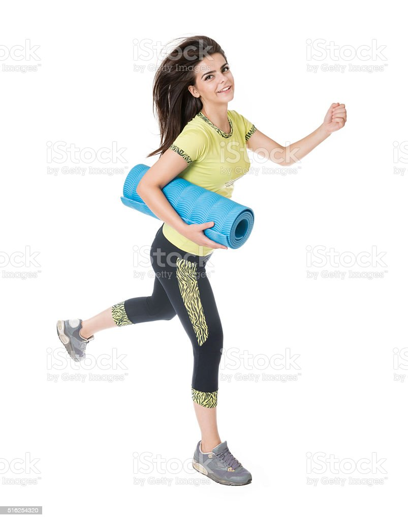 Healthy Woman Athlete Holding Pilates mat and Exercise stock photo