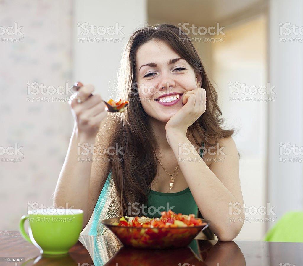 healthy woman eating veggie salad stock photo